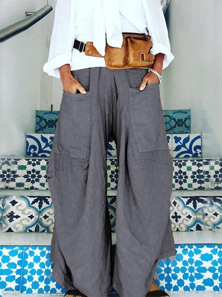 المرأة واسعة الساق مرونة الخصر الصرفة اللون جيوب السراويل